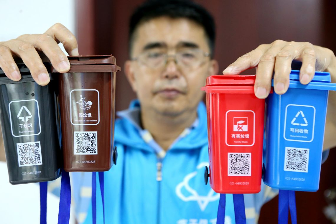 Miniature replicas of Shanghai's new waste-sorting bins were used to help locals learn the
