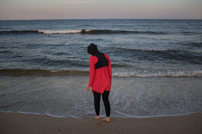 Manar Hussein at a beach in New Jersey June 26, 2019. This was Hussein's first time wearing a burkini in the water. Kholood E