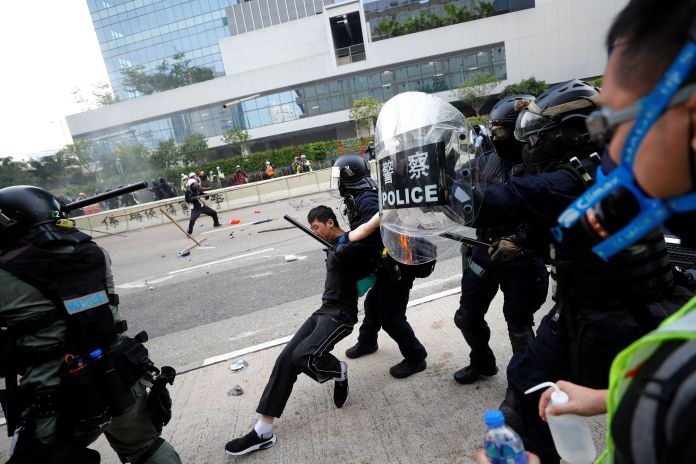 Riot police intercept protester during clash in Hong Kong