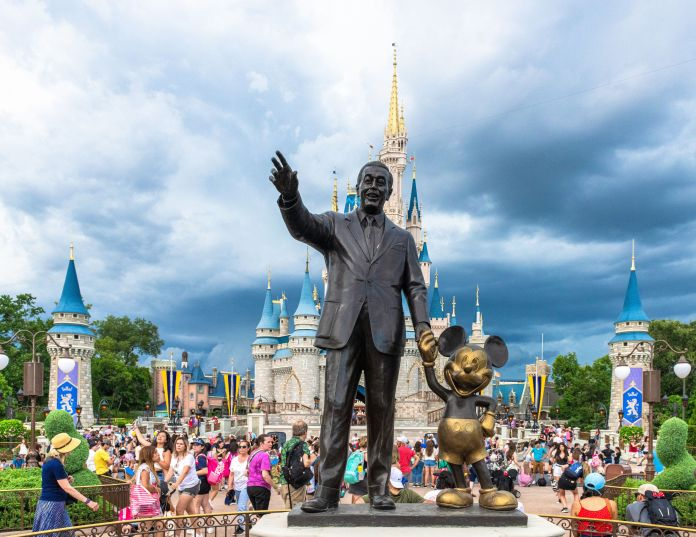 Walt Disney and Mickey Mouse statue inside of the Magic Kingdom at Disney World.