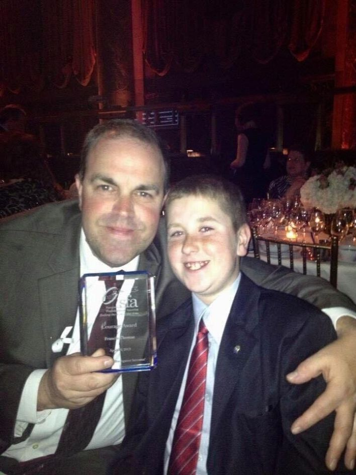 Thomas's dad, with her younger brother, at a ceremony where he received the Courage Award from the Sarcoma Foundation of Amer