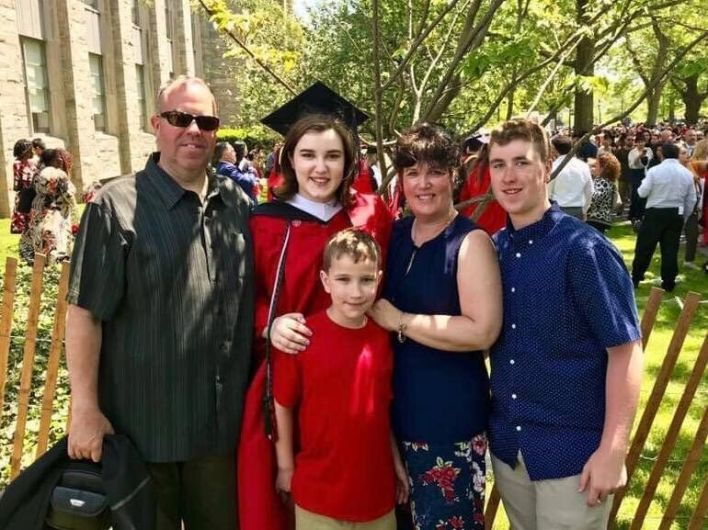 Thomas with her dad, mom and two brothers at her college graduation in May 2019.