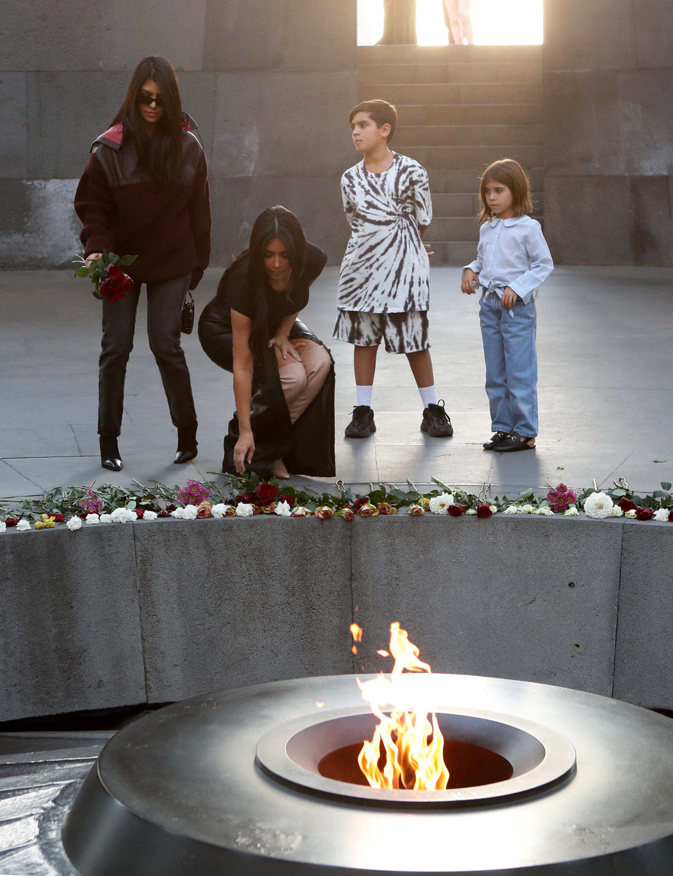 Reality TV personality Kim Kardashian and her sister Kourtney Kardashian with children visit the Armenian Genocide Memorial i