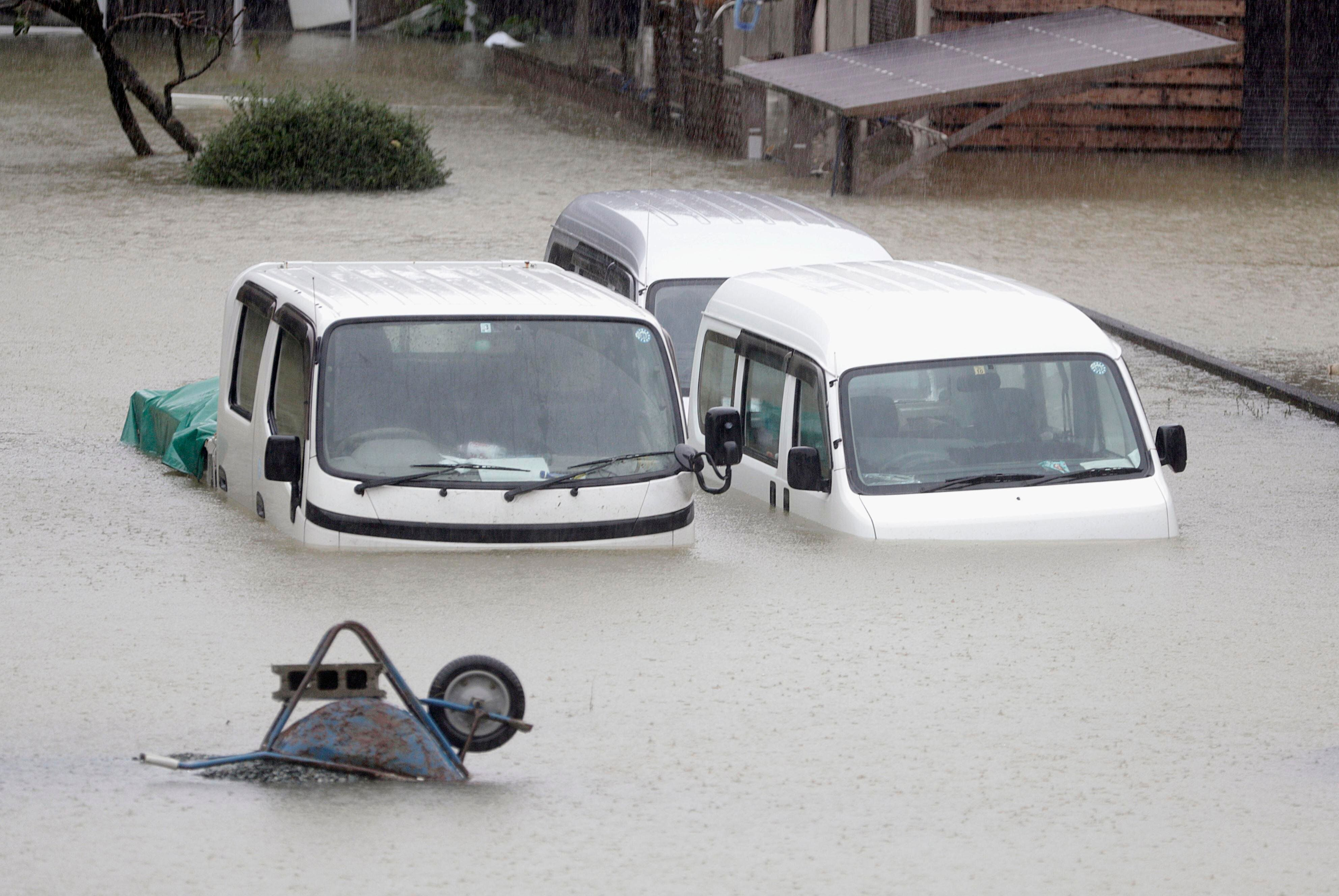 Cars sit submerged in water in the residential area hit by Typhoon Hagibis, in Ise, central Japan Saturday, Oct. 12, 2019. A