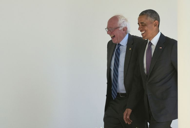 Then-President Barack Obama, right, walks with 2016 Democratic presidential candidate Sen. Bernie Sanders of Vermont at the W