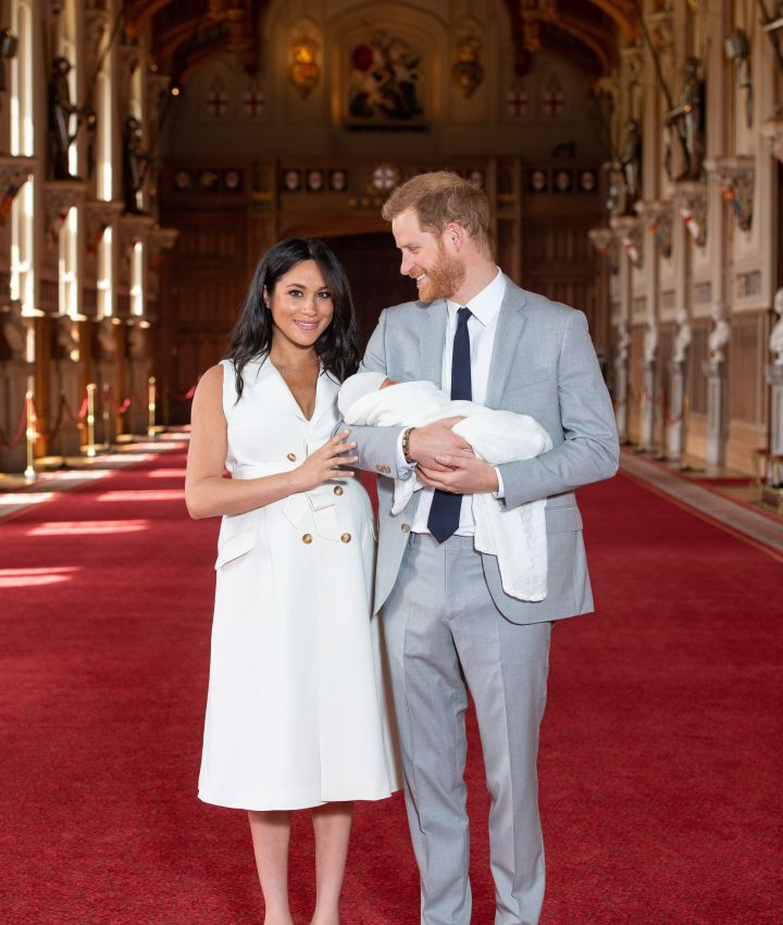 Meghan and Harry pose with their newborn son Archie Harrison Mountbatten-Windsor in St George's Hall at Windsor Castle on May 8 in Windsor, England.
