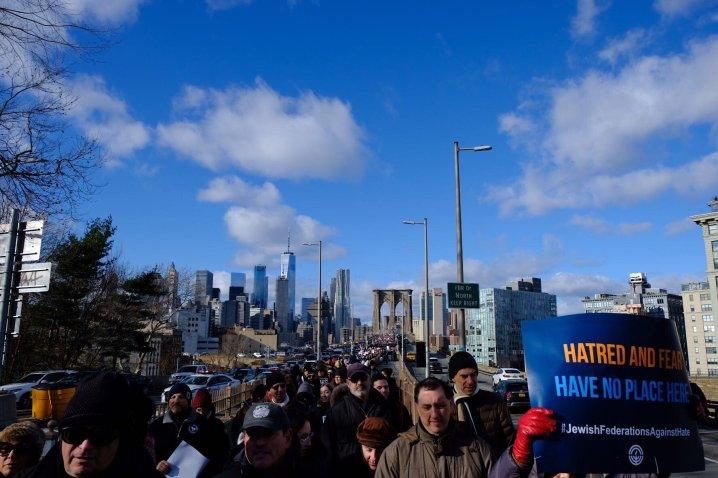 Demonstrators crossed the Brooklyn Bridge as they made their way to Cadman Plaza, where community leaders spoke against anti-