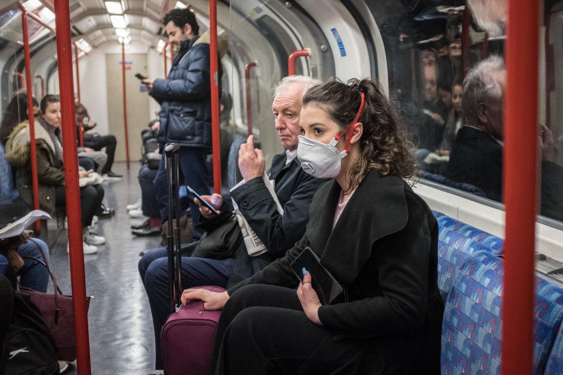 A woman seen on a tube wearing a face mask. A total of nine people in the UK are now being treated for COVID-19, the disease caused by the coronavirus. Doctors have warned that the London Underground could be a hotbed for the coronavirus. (Photo by S.C. Leung / SOPA Images/Sipa USA)