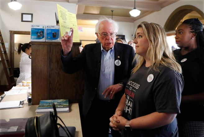 Sanders holds an insulin vial as he talks with Quinn Nystrom at the Olde Walkerville Pharmacy on July 28, 2019, in Windsor, O