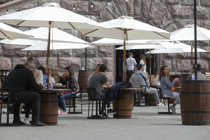 People dine outdoors in Kyiv, Ukraine, on May 11, 2020. Ukraine is allowing visits to parks, squares, recreational areas and some businesses as it starts a gradual exit from COVID-19 quarantine.
