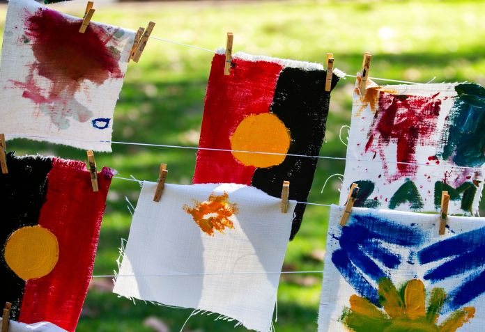 SYDNEY, AUSTRALIA - JULY 13: Artworks painted by children on the day are displayed at Hyde Park on July 13, 2019 in Sydney, Australia. NAIDOC Week celebrations are held across Australia each year to celebrate the history, culture and achievements of Aboriginal and Torres Strait Islander peoples. NAIDOC is celebrated not only in Indigenous communities, but by Australians from all walks of life. (Photo by Jenny Evans/Getty Images)