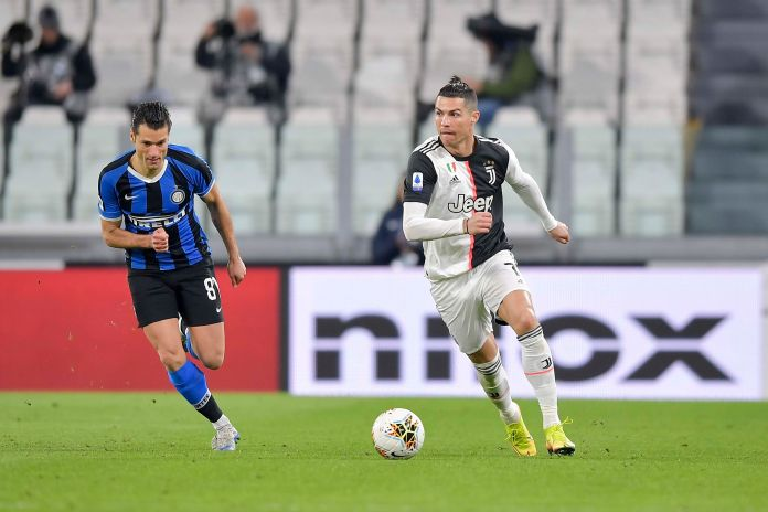 TURIN, ITALY - MARCH 08: Cristiano Ronaldo of Juventus competes for the ball with Antonio Candreva of ...