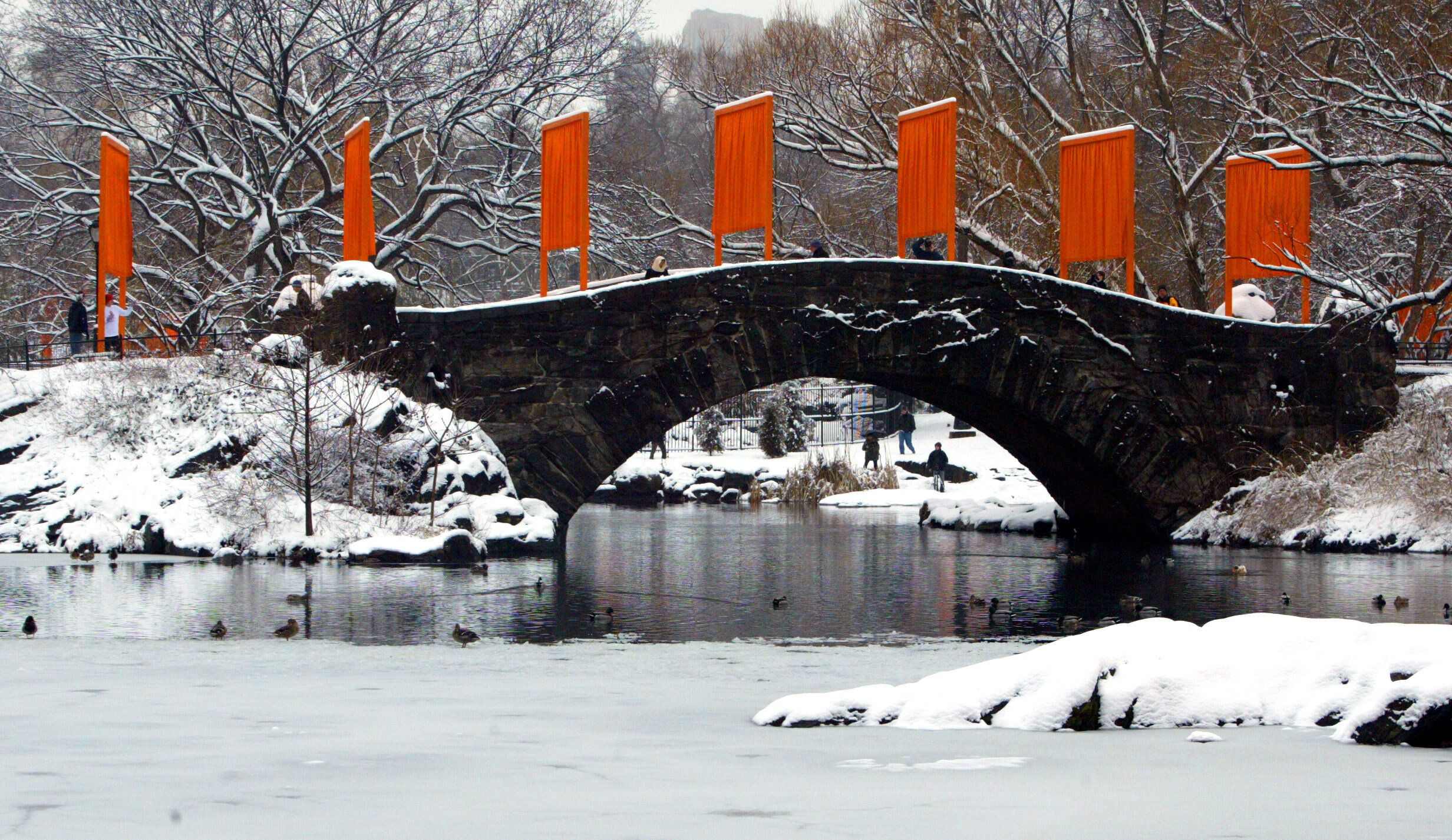 """The Gates"" art installation created by Christo and Jeanne-Claude lines a snow-covered bridge in New York's Central Park in 2"