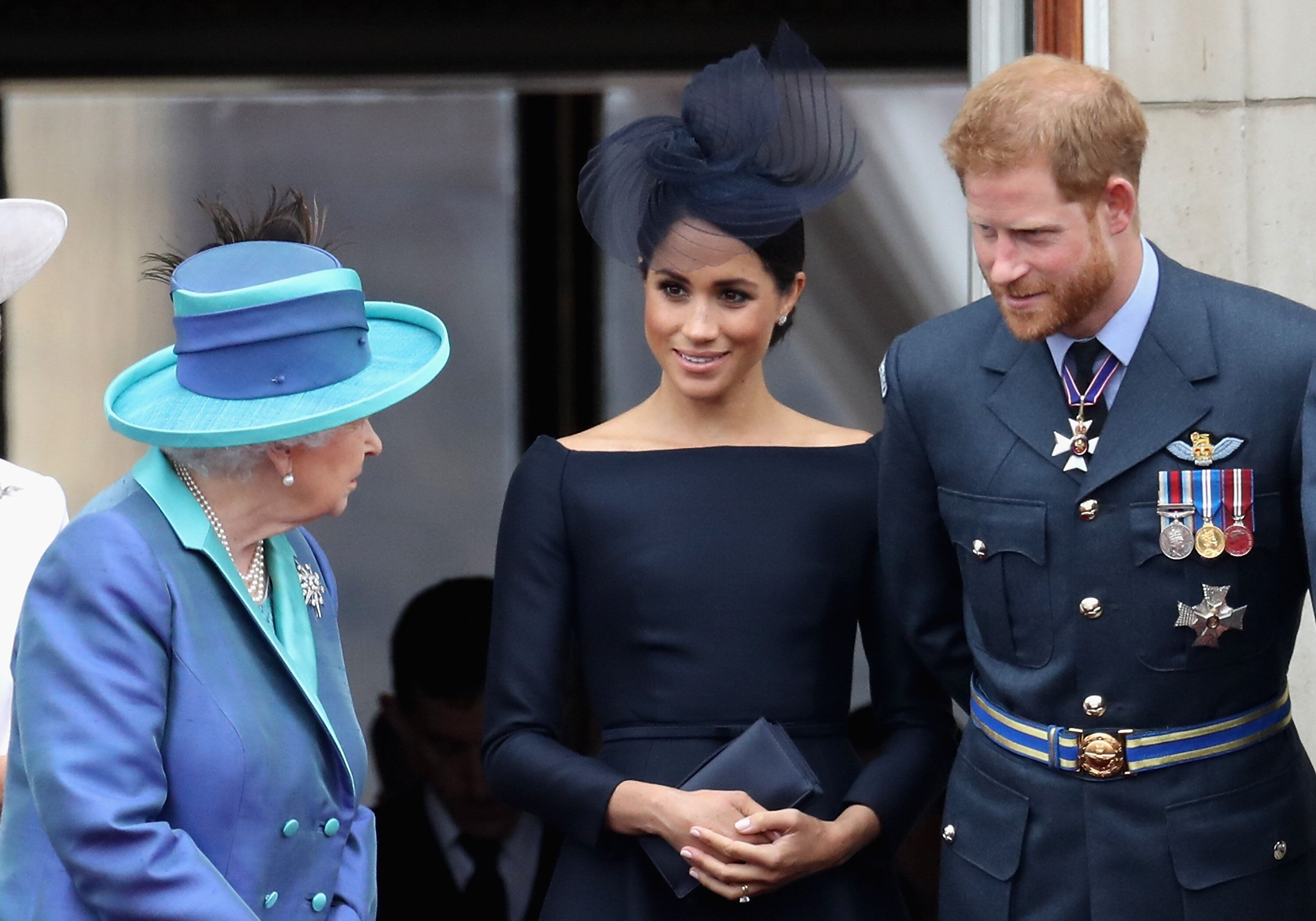 Queen Elizabeth II and the Duke and Duchess of Sussex chat on the balcony of Buckingham Palace on July 10, 2018.