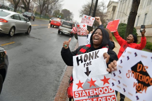 Cory Gardner Supporters of statehood for Washington, D.C., cheer as drivers honk their horns in support outside the Rayburn House Office B