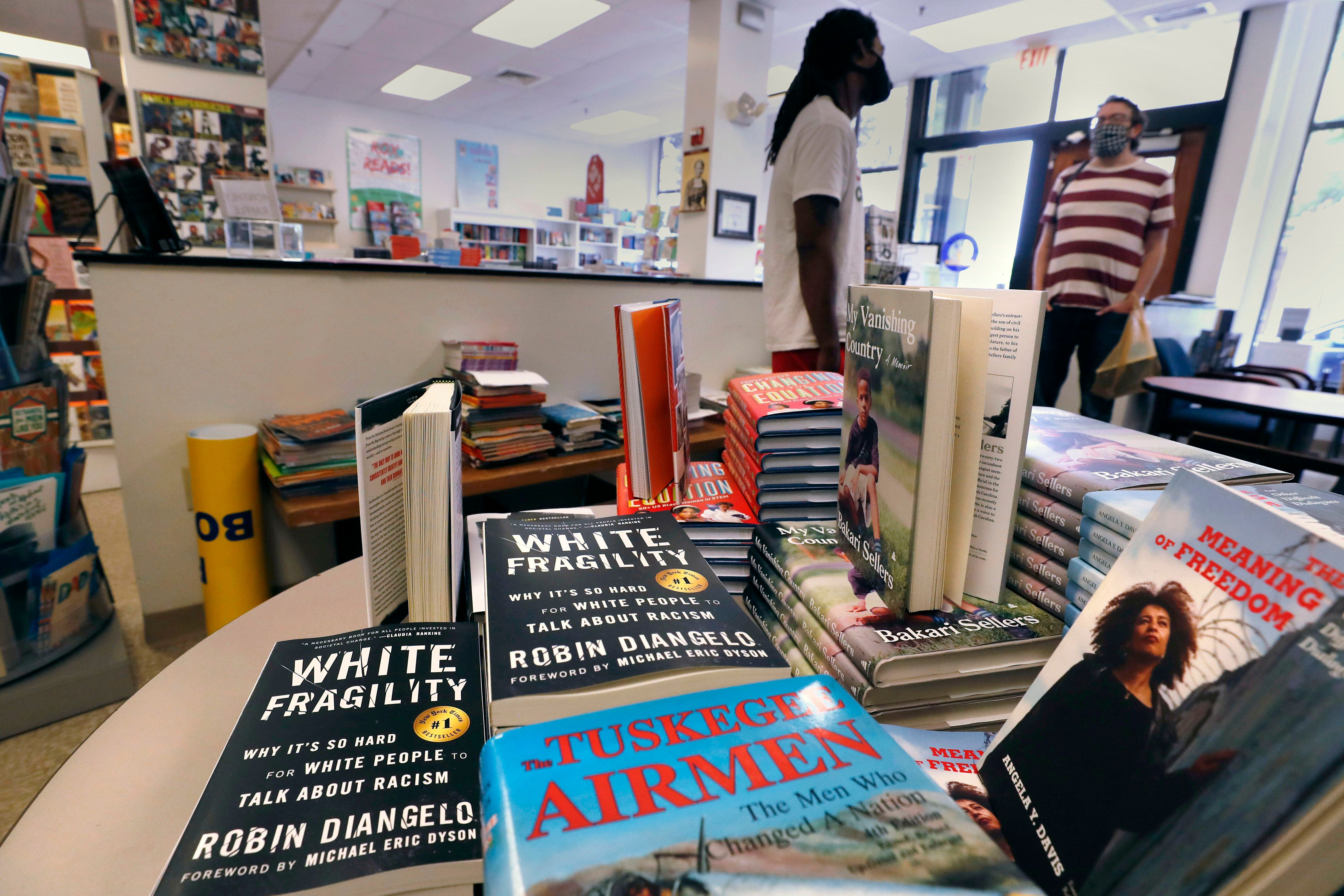 """Books including """"The Tuskegee Airmen"""" and """"White Fragility"""" on display in June at the Black-owned Frugal Bookstore in Boston."""