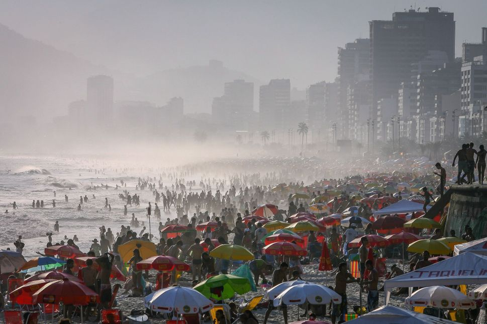Thousands of people flock to Ipanema beach in Rio de Janeiro. Beach access was banned in March 2020 due to the pandemic and still remains so, with some exceptions. Despite this, thousands of people still visit Rio's beaches daily. Above: Oct. 26, 2008| Below: July 23, 2020