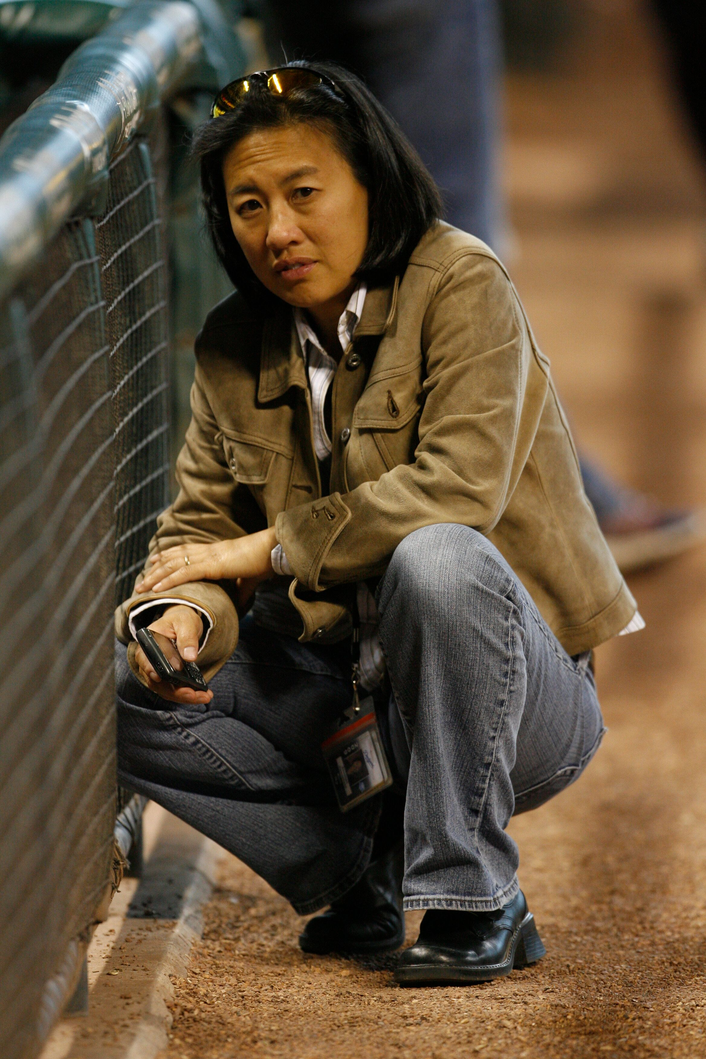 Kim Ng, then the Los Angeles Dodgers vice president and assistant general manager, looks on prior to a 2009 game.