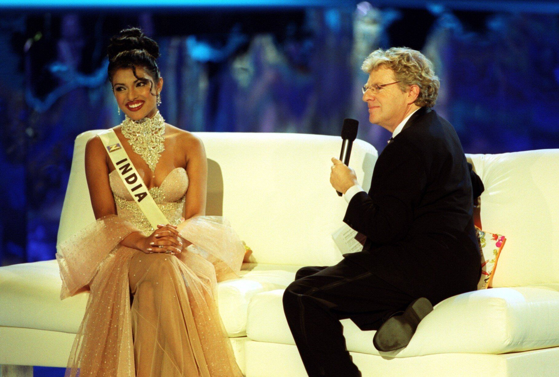 Chopra, then 18, speaks with host Jerry Springer during the Miss World 2000 contest.