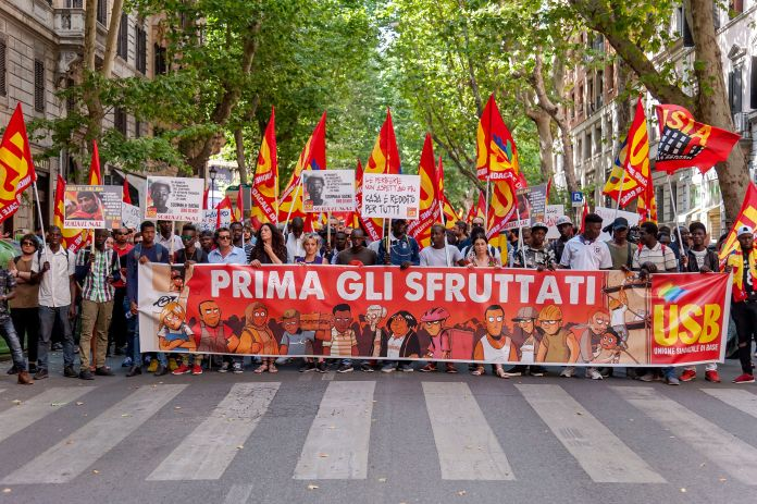 People protested during an anti-racist protest against Mateo Salvini's decision to close Italian ports to N.