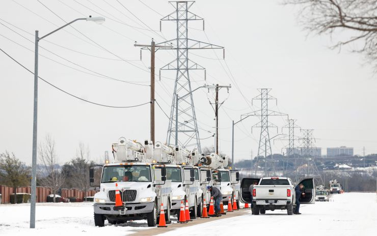 Pike Electric service trucks line up after the snowstorm on Feb. 16 in Fort Worth, Texas.