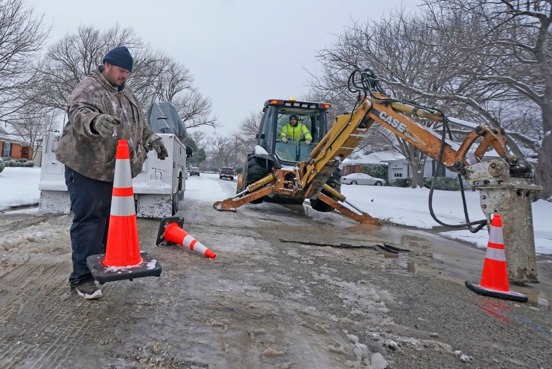 City employees prepare to work on a water main pipe that burst due to extreme cold in Richardson, Texas, on Wednesday.