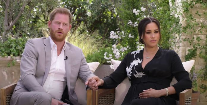 The Duke and Duchess of Sussex pictured in a still from their interview with Oprah Winfrey.