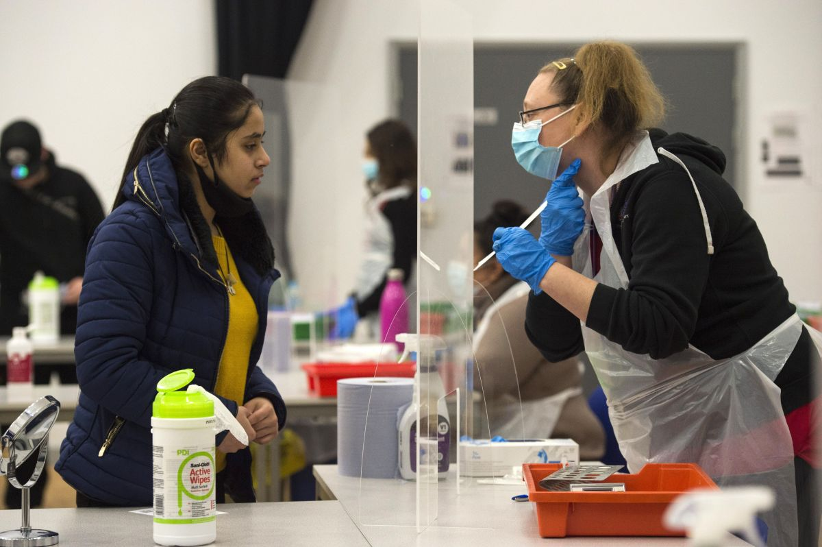 A student takes a Lateral Flow Test at Hounslow Kingsley Academy in West London, as pupils in England...