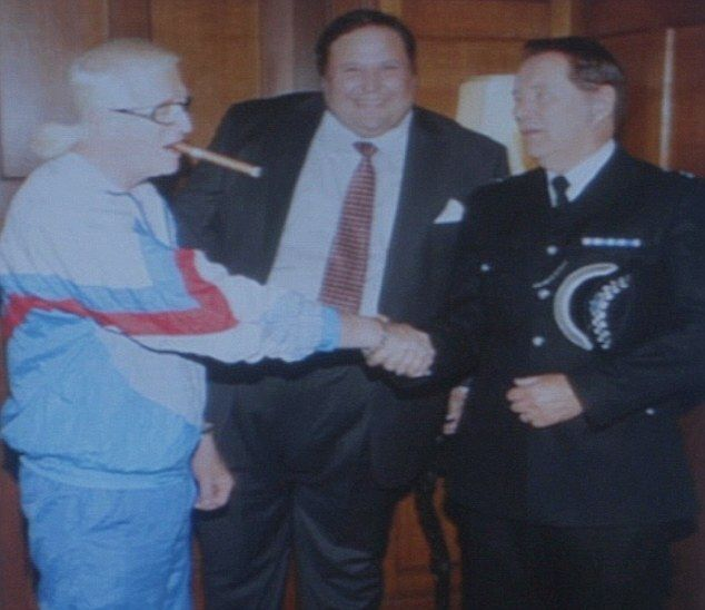 Councillor Dale Roach (middle) andChief Superintendent Patrick Fairbank had fictional links to...
