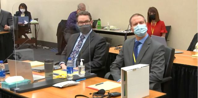 Derek Chauvin, right, with his attorney Eric Nelson in Hennepin County court in Minneapolis.