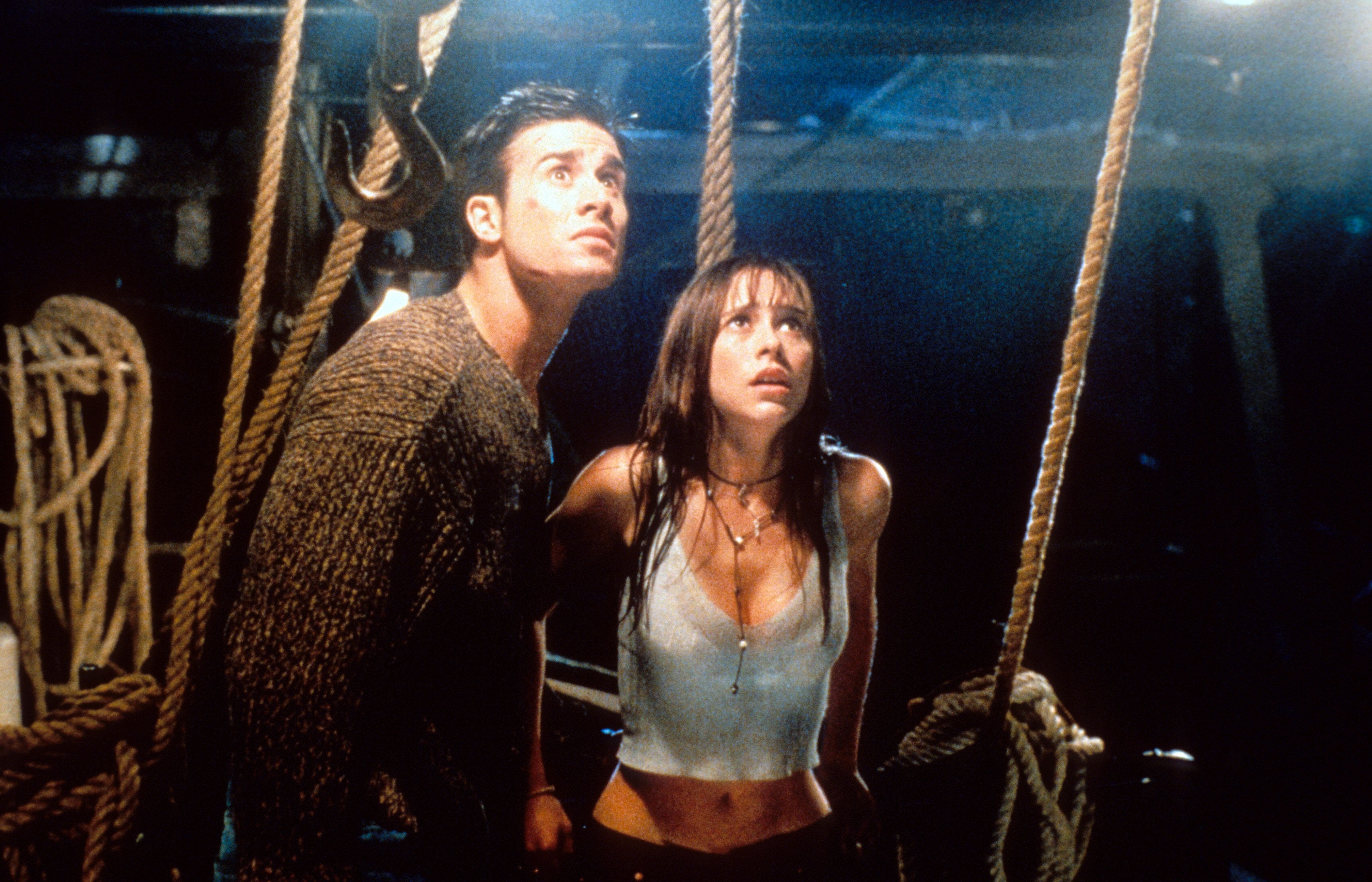 "Freddie Prinze Jr and Jennifer Love Hewitt looking up in fear in a scene from the film ""I Still Know What You Did Last Summer"