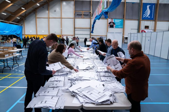 Electoral workers count ballots during legislative elections in Nuuk, Greenland, on April 6, 2021. -...