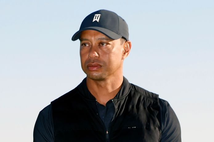 In this Feb. 21, 2021, file photo, Tiger Woods looks on during the trophy ceremony on the practice green after the final roun
