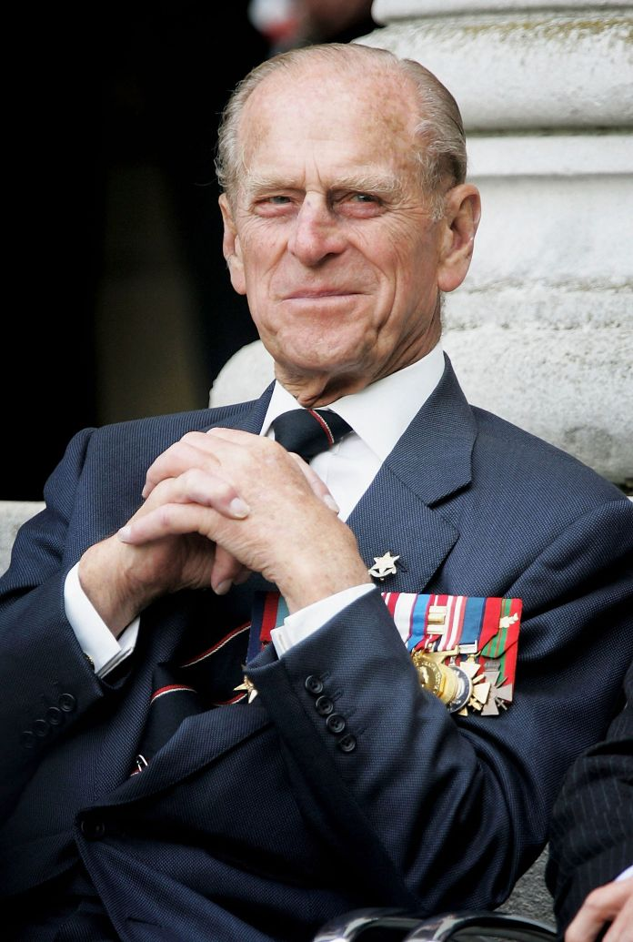 The Duke of Edinburgh watches the Gurka band march past as World War II veterans gather to commemorate the 60th anniversary a