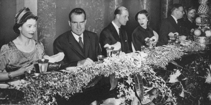 Queen Elizabeth, Vice President Richard Nixon, Prince Philip and Mrs. Pat Nixon, (l. to r.), seated at a table in Old Supreme