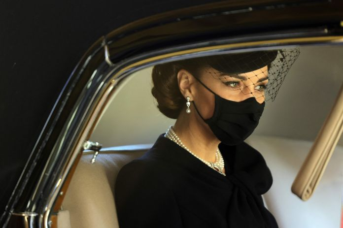 The Duchess of Cambridge arrives, mask on, for the funeral.