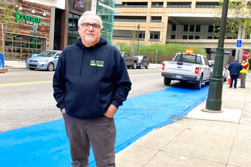 Detroit Pizza Man Paints Street Blue To Save People Some Green Money