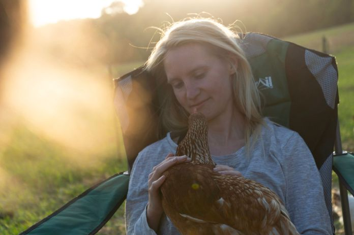 Abby Johnson with one of her hens.