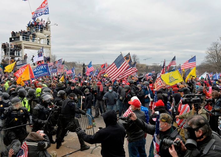 Trump supporters clash with police and security forces as they storm the U.S. Capitol on Jan. 6, 2021.