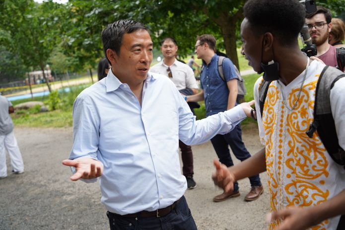 Andrew Yang talks to a voter in Manhattan's Morningside Park on Saturday. Once a frontrunner, the businessman and former pres