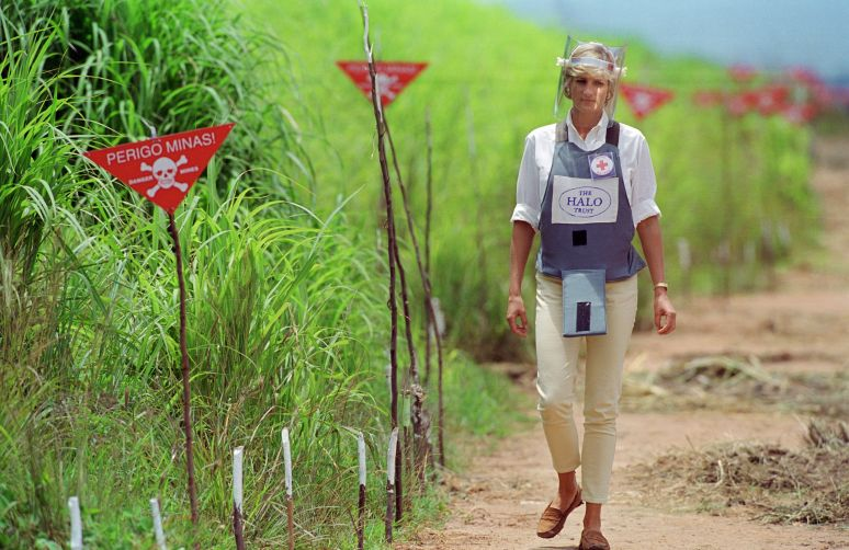 The Princess of Wales wearing protective body armor and a visor as she visits a landmine minefield being cleared by the chari