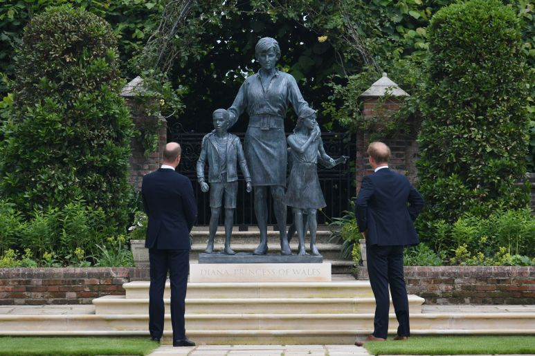William and Harry look at a statue they commissioned of their mother.