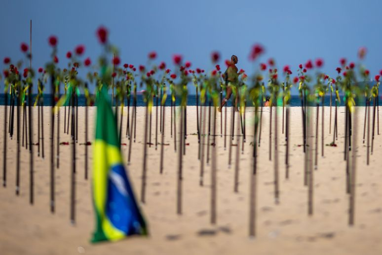 """A makeshift memorial was """"planted"""" on beaches in Rio de Janeiro in June to mark Brazil's recording of its 500,000th death rel"""