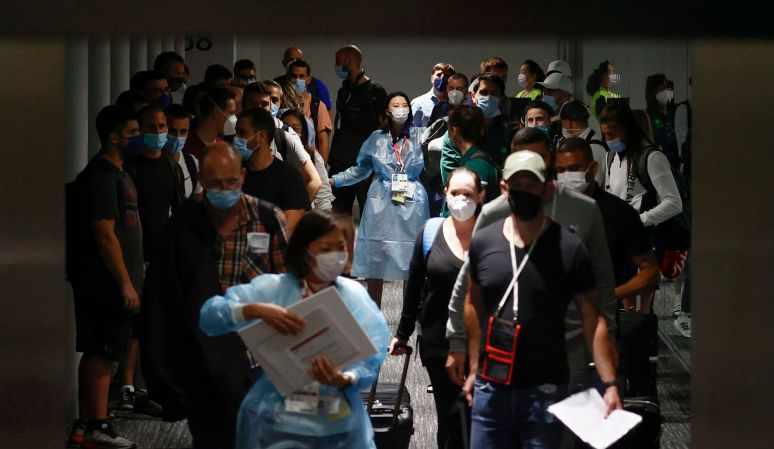 In this July 1, 2021, file photo, Olympic officials guide Ireland's athletes on their arrival at Narita international airport