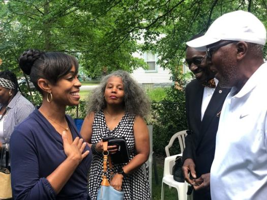 Shontel Brown, left, talks with voters. She and Turner have accused one another of corruption and insufficient loyalty to the