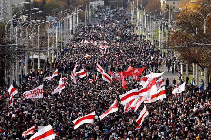 Opposition supporters parade through the streets during a rally to protest against the Belarus presidential...
