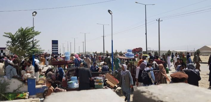 Afghans continue to wait around the Hamid Karzai International Airport as they try to leave the Afghan capital of Kabul on Sa