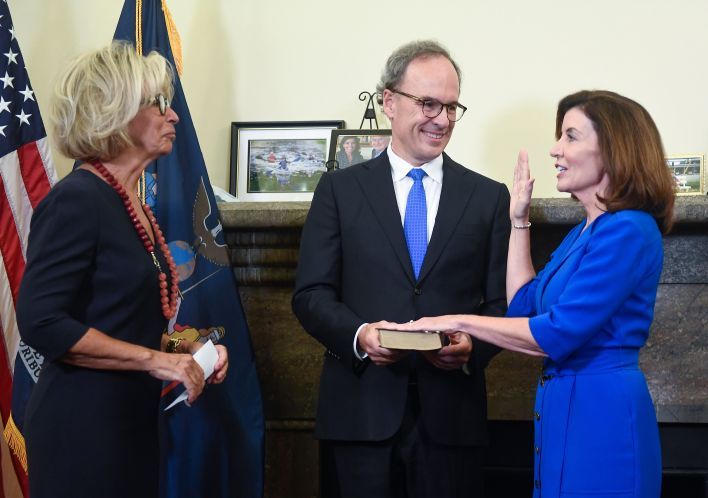 Kathy Hochul, right, became the first female governor of New York at the stroke of midnight Tuesday.