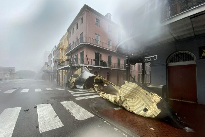 A section of a building's roof is seen after being blown off during rain and winds in the French Quarter of New Orleans, Loui