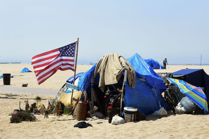 Homelessness in California has risen by 24% since 2018. Public encampments like this one at Venice Beach in Los Angeles have